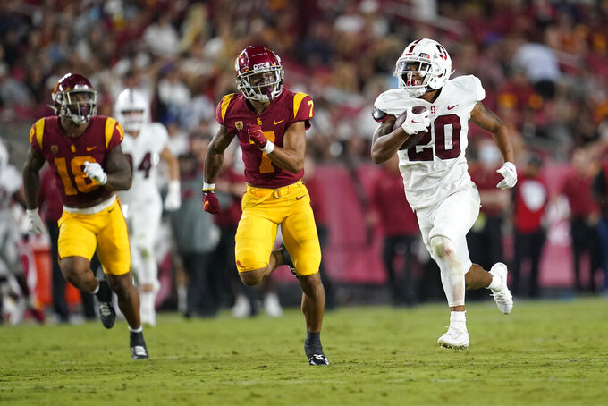 Stanford running back Austin Jones (20) runs past Southern California safety Chase Williams (7) during the first half of an NCAA college football game Saturday, Sept. 11, 2021, in Los Angeles. (AP Photo/Marcio Jose Sanchez)