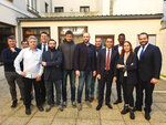FILE - In this photo taken on Feb. 5, 2019 provided by the 5-Star Movement, Christophe Chalencon, fifth from right, one of the leading figures of the yellow vest movement, poses for a group photo with yellow vests' members and Italy's 5-Star Movement's leaders Luigi Di Maio, fourth from right, and Alessandro Di Battista, sixth from left, near Paris. The offer by Italy's 5-Star Movement to share its web platform with France's