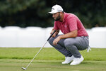 Jon Rahm looks over his putt on the second hole during the final round of play in the Tour Championship golf tournament at East Lake Golf Club, Sunday, Sept. 5, 2021, in Atlanta. (AP Photo/Brynn Anderson)