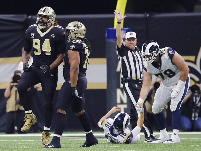 New Orleans Saints' Cameron Jordan (94) reacts after sacking Los Angeles Rams' Jared Goff (16) during the second half the NFL football NFC championship game Sunday, Jan. 20, 2019, in New Orleans. (AP Photo/Carolyn Kaster)