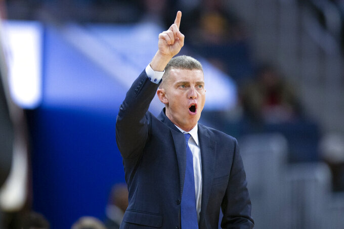 San Diego head coach Sam Scholl shouts instructions to his players during the first half of an NCAA college basketball game against Stanford on Saturday, Dec. 21, 2019, in San Francisco. (AP Photo/D. Ross Cameron)