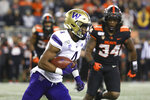 Washington wide receiver Terrell Bynum (4) dodges Oregon State players, including Avery Roberts (34), during the first half of an NCAA college football game in Corvallis, Ore., Friday, Nov. 8, 2019. (AP Photo/Amanda Loman)