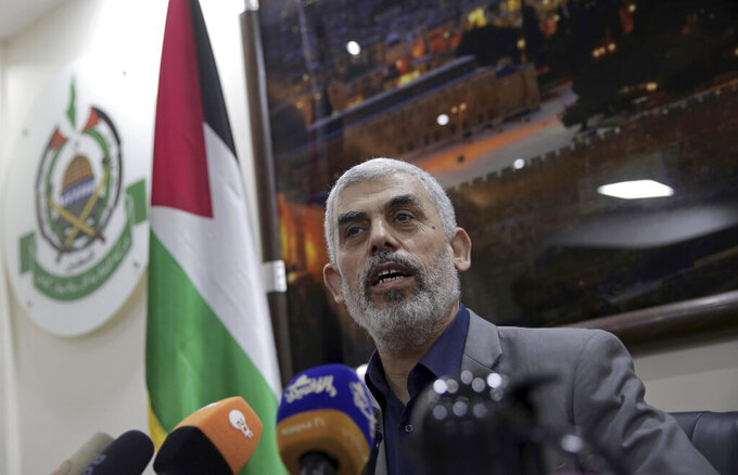FILE - In this May 10, 2018 file photo, Yehiyeh Sinwar, the Hamas militant group's leader in the Gaza Strip, speaks to foreign correspondents, in his office in Gaza City. A Hamas official said Wednesday,March 10, 2021, that Sinwar has been re-elected as the group's top official in its Gaza Strip stronghold. Sinwar, who is close to the group's hardline militant wing, fended off a challenge by Nizar Awadallah, one of its founders. (AP Photo/Khalil Hamra, File)