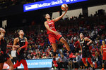 Washington Mystics guard Natasha Cloud, center, goes to the basket between Las Vegas Aces guard Kelsey Plum, right, and guard Kayla McBride, left, during the first half of Game 2 of a WNBA playoff basketball series, Thursday, Sept. 19, 2019, in Washington. (AP Photo/Nick Wass)