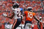 Chicago Bears cornerback Kyle Fuller (23) intercepts a pass intended for Denver Broncos wide receiver Emmanuel Sanders (10) during the second half of an NFL football game, Sunday, Sept. 15, 2019, in Denver. (AP Photo/David Zalubowski)