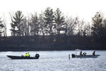 Law enforcement resume the search for a missing Iowa State University Crew Club member on Monday, March 29, 2021, at Little Wall Lake in Hamilton County. The ISU student has been missing since the rescue of three other students and the death of one on the lake Sunday. (Kelsey Kremer/The Des Moines Register via AP)