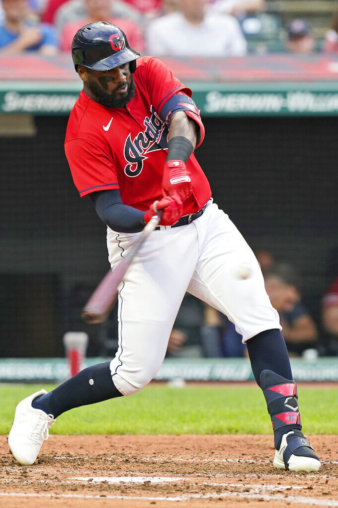 Cleveland Indians' Franmil Reyes hits a three-run home run during the third inning of the team's baseball game against the Tampa Bay Rays, Thursday, July 22, 2021, in Cleveland. (AP Photo/Tony Dejak)