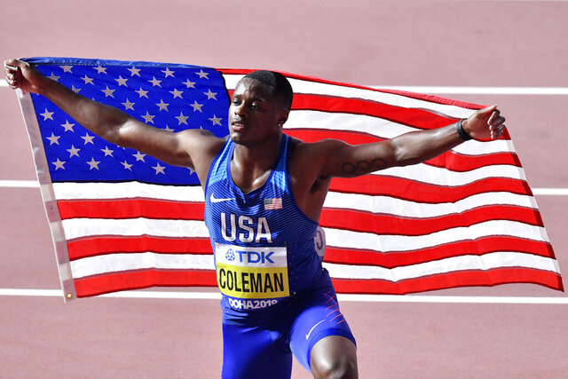 FILE - In this Sept. 28, 2019, file photo, Christian Coleman, of the United States, poses after winning the men's 100 meter race during the World Athletics Championships in Doha, Qatar. Reigning world champion Coleman insists a simple phone call from drug testers while he was out Christmas shopping could've prevented the latest misunderstanding about his whereabouts, one he fears could lead to a suspension. (AP Photo/Martin Meissner, File)