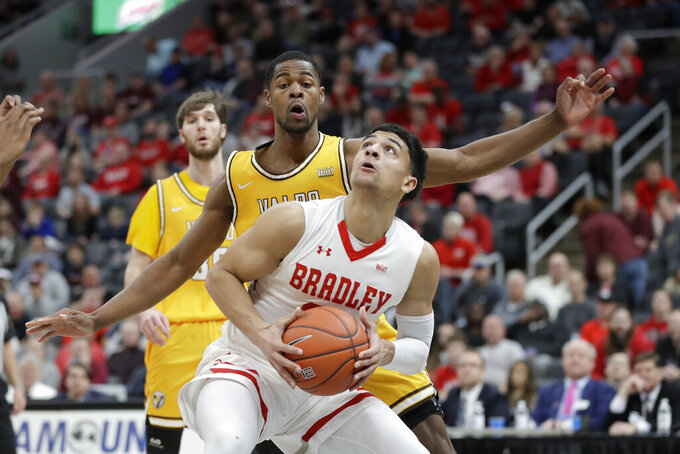 Bradley's Ja'Shon Henry, front, looks to the basket as Valparaiso's Mileek McMillan defends during the first half of an NCAA college basketball game in the championship of the Missouri Valley Conference men's tournament Sunday, March 8, 2020, in St. Louis. (AP Photo/Jeff Roberson)