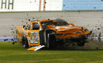 David Starr plows through the infield after crashing in Turn 4 during the NASCAR Xfinity Series auto race at Texas Motor Speedway in Fort Worth, Texas, Saturday, Nov. 2, 2019. (David Kent/Star-Telegram via AP)