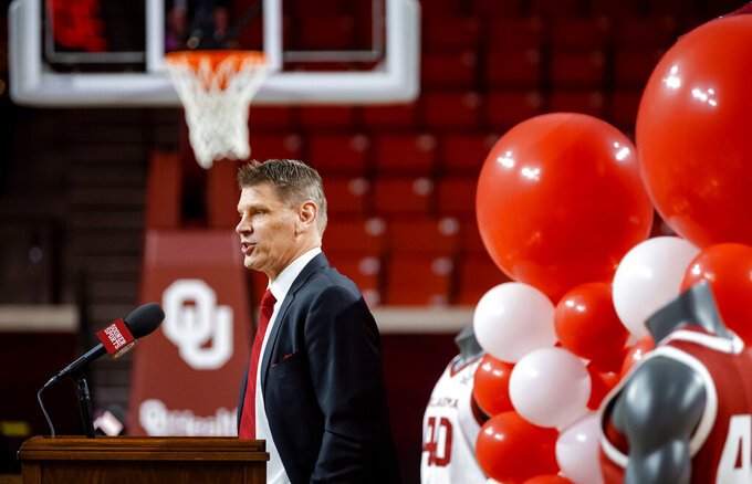 University of Oklahoma's new men's NCAA college basketball coach Porter Moser speaks during his introductory press conference at Lloyd Noble Center in Norman, Okla., Wednesday, April 7, 2021. (Chris Landsberger/The Oklahoman via AP)