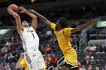 Loyola of Chicago's Lucas Williamson (1) heads to the basket as Valparaiso's Javon Freeman-Liberty (0) defends during the second half of an NCAA college basketball game in the quarterfinal round of the Missouri Valley Conference men's tournament Friday, March 6, 2020, in St. Louis. Valparaiso won 74-73 in overtime. (AP Photo/Jeff Roberson)