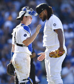 Los Angeles Dodgers relief pitcher Kenley Jansen, right, celebrates with catcher Will Smith after the team's baseball game against the New York Yankees in Los Angeles, Saturday, Aug. 24, 2019. The Dodgers won 2-1. (AP Photo/Kelvin Kuo)