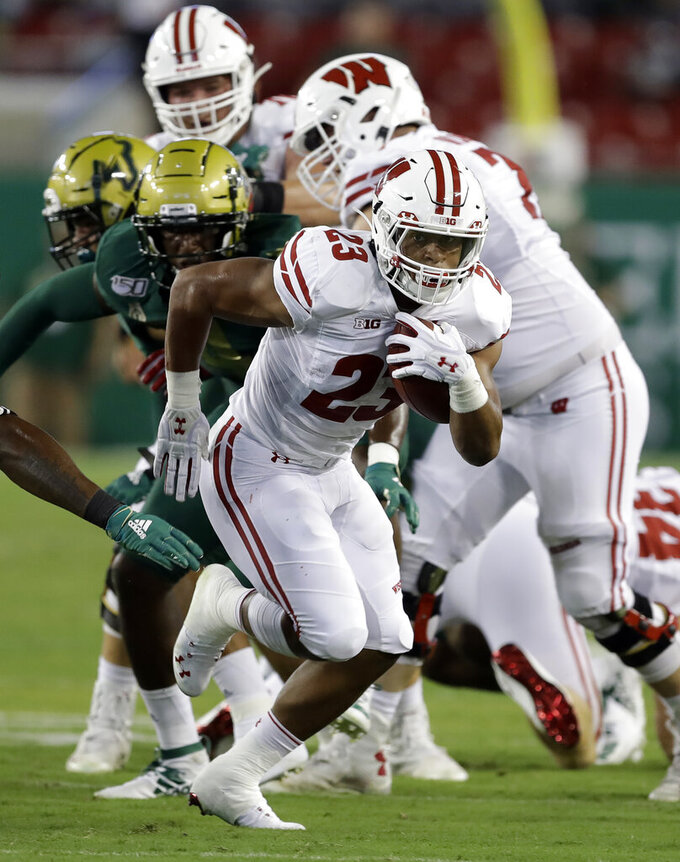 Wisconsin running back Jonathan Taylor (23) runs 37 yards for a touchdown during the first half of the team's NCAA college football game against South Florida on Friday, Aug. 30, 2019, in Tampa, Fla. (AP Photo/Chris O'Meara)