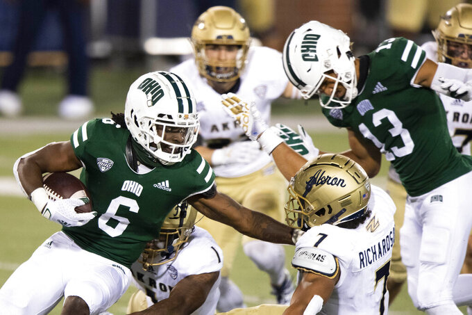 FILE — In this Nov. 10, 2020 file photo, Ohio Bobcats wide receiver Isiah Cox (6) runs the ball past Akron Zips linebacker Julian Richardson (7) during an NCAA football game in Athens, Ohio. An NCAA official voiced concern, Thursday, Nov. 12, 2020, over sports betting on the performance of individual student athletes, and suggested that gambling regulators consider restrictions on such wagers to protect the integrity of the games. (AP Photo/Emilee Chinn, FIle)