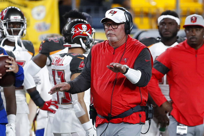 Tampa Bay Buccaneers coach Bruce Arians, center, walks the sideline during the second half of the team's NFL football game against the Pittsburgh Steelers in Pittsburgh, Friday, Aug. 9, 2019. (AP Photo/Keith Srakocic)