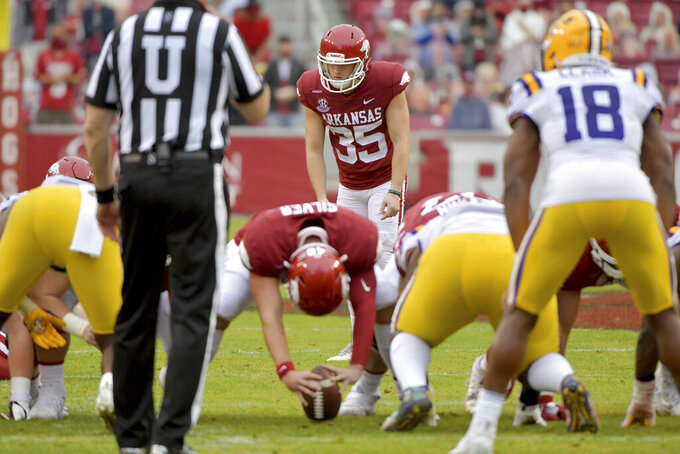 Arkansas kicker A.J. Reed gets ready to attempt a field goal to tie the game against LSU during the second half of an NCAA college football game Saturday, Nov. 21, 2020, in Fayetteville, Ark. (AP Photo/Michael Woods)