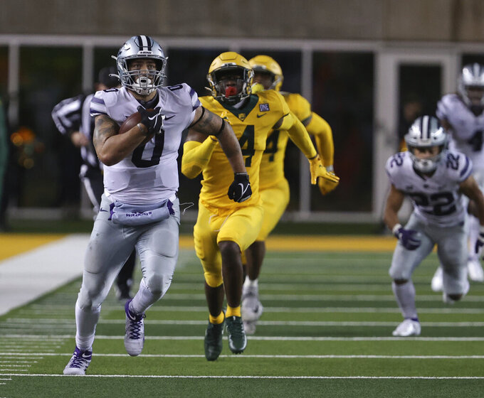 Kansas State tight end Briley Moore, left, sprints past Baylor safety Christian Morgan during the second half of an NCAA college football game Saturday, Nov. 28, 2020, in Waco, Texas. (Rod Aydelotte/Waco Tribune Herald via AP)