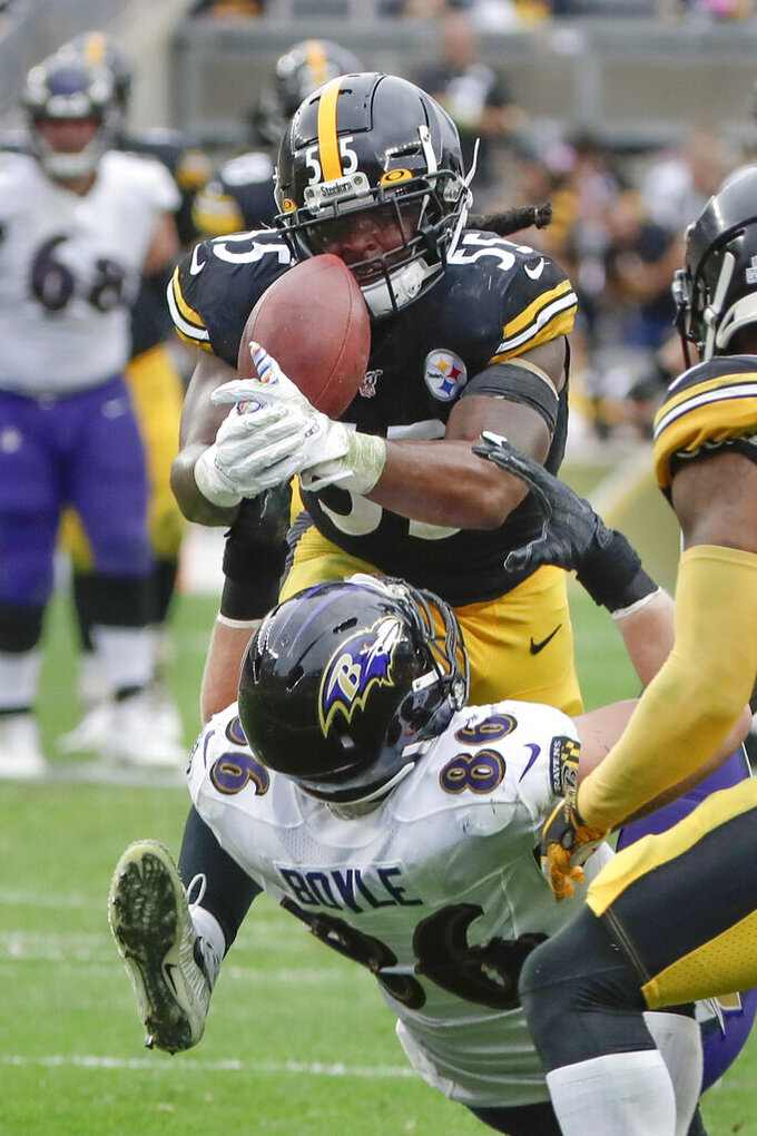 Pittsburgh Steelers linebacker Devin Bush (55) intercepts a pass intended for Baltimore Ravens tight end Nick Boyle (86) during the second half of an NFL football game Sunday, Oct. 6, 2019, in Pittsburgh. (AP Photo/Gene Puskar)