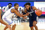 Connecticut's R.J. Cole (1) drives against DePaul's Charlie Moore during the first half of an NCAA college basketball game Monday, Jan. 11, 2021, in Chicago. (AP Photo/Charles Rex Arbogast)