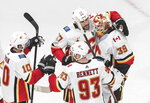 Calgary Flames players celebrate the win over the Dallas Stars during a first-round NHL Stanley Cup playoff hockey game in Edmonton, Alberta, Tuesday, Aug. 11, 2020. (Jason Franson/The Canadian Press via AP)