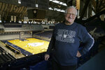 "FILE - In this Dec. 20, 2016, file photo, Bobby Plump, star of the 1954 Milan state championship basketball team, poses at Hinkle Fieldhouse in Indianapolis. ""The Indiana high school tournament is still special, not as special as it used to be, but it's still special,"" said Plump, whose winning shot in the 1954 state championship game became the inspiration for ""Hoosiers."" (AP Photo/Michael Conroy, File)"