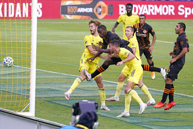 Houston Dynamo defender Maynor Figueroa, second from left, scores a goal from inside a trio of Nashville SC defenders during the second half of an MLS soccer match Saturday, Sept. 26, 2020, in Nashville, Tenn. The game ended in a 1-1 draw. (AP Photo/Mark Humphrey)