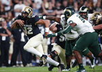 Colorado quarterback Steven Montez, left, drives for a long gain past Colorado State defensive lineman Ellison Hubbard in the first quarter of an NCAA college football game Friday, Aug. 30, 2019, in Denver. (AP Photo/David Zalubowski)