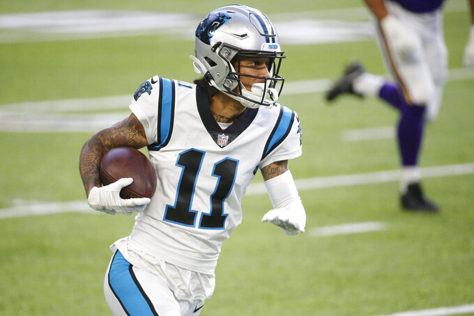 Carolina Panthers wide receiver Robby Anderson runs up field during a 41-yard touchdown reception during the first half of an NFL football game against the Minnesota Vikings, Sunday, Nov. 29, 2020, in Minneapolis. (AP Photo/Bruce Kluckhohn)