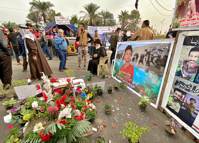 Posters of Anti-government protesters who have been killed in demonstrations are displayed in Tahrir Square during ongoing protests in Baghdad, Iraq, Thursday, Dec. 12, 2019.   (AP Photo/Khalid Mohammed)