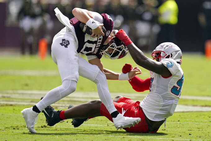 New Mexico defensive end Justin Harris (97) sacks Texas A&M defensive lineman Fadil Diggs (10) for a 14-yard loss during the first half of an NCAA college football game on Saturday, Sept. 18, 2021, in College Station, Texas. (AP Photo/Sam Craft)