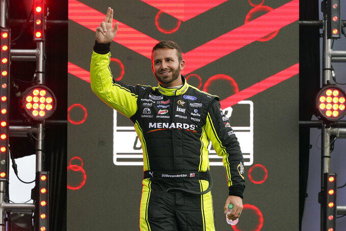 Matt DiBenedetto waves to fans during driver introductions before the NASCAR Cup Series auto race at Daytona International Speedway, Saturday, Aug. 28, 2021, in Daytona Beach, Fla. (AP Photo/John Raoux)