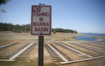 Empty boat docks sit on dry land at the Browns Ravine Cove area of drought-stricken Folsom Lake, currently at 37% of its normal capacity, in Folsom, Calif., Saturday, May 22, 2021. California Gov. Gavin Newsom declared a drought emergency for most of the state. (AP Photo/Josh Edelson)