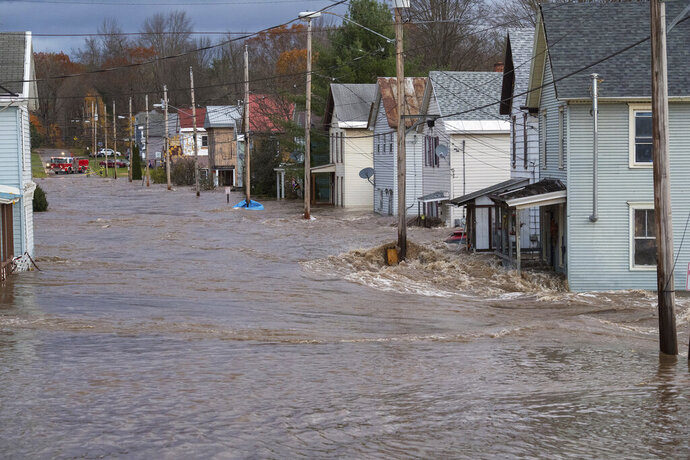 In this photo provided by the New York State Governor's Office, houses are flooded by rising waters of the East Canada Creek, Friday, Nov. 1, 2019 in Dolgeville, N.Y. Several hundred people were being evacuated in scattered areas around the state because of high waters.  (Darren McGee/New York State Governor's Office via AP)