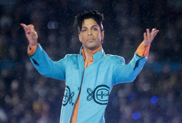 FILE - This Feb. 4, 2007 file photo shows Prince performing during the halftime show at the Super Bowl XLI football game at Dolphin Stadium in Miami. John Legend, Foo Fighters, Alicia Keys, Chris Martin, H.E.R. and Earth, Wind & Fire are set to perform at a Prince tribute concert this month. The Recording Academy announced Thursday that