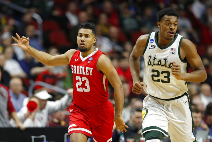 Bradley guard Dwayne Lautier-Ogunleye, left, celebrates in front of Michigan State forward Xavier Tillman after making a three-point basket during a first round men's college basketball game in the NCAA Tournament, Thursday, March 21, 2019, in Des Moines, Iowa. (AP Photo/Charlie Neibergall)