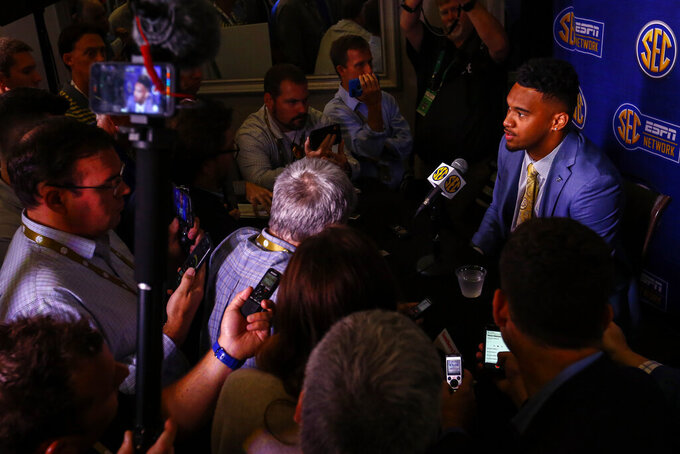 Alabama quarterback Tua Tagovailoa speaks to reporters during the NCAA college football Southeastern Conference Media Days, Wednesday, July 17, 2019, in Hoover, Ala. (AP Photo/Butch Dill)