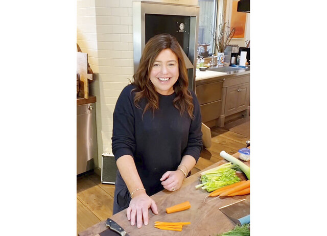 In this undated photo made available by the Rachael Ray Show, Rachael Ray cooks in her home kitchen in upstate New York. Ray is taping