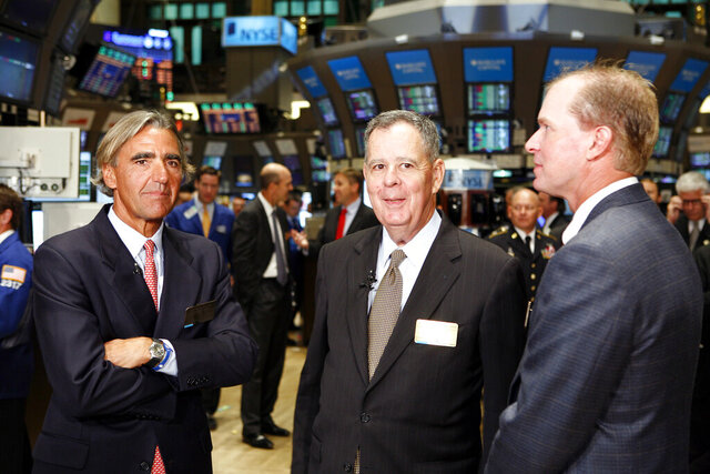 FILE - In this Sept. 1, 2010, file photo, Deutsche Bank Americas CEO Seth Waugh, left, Assistant Secretary of Defense for Reserve Affairs Dennis McCarthy, center, and PGA Tour Pro Steve Stricker, right, visit the trading floor of the New York Stock Exchange after they rang the opening bell. Waugh, now CEO of the PGA of America, says it's possible to play the PGA Championship at Harding Park without fans. (AP Photo/David Karp, File)