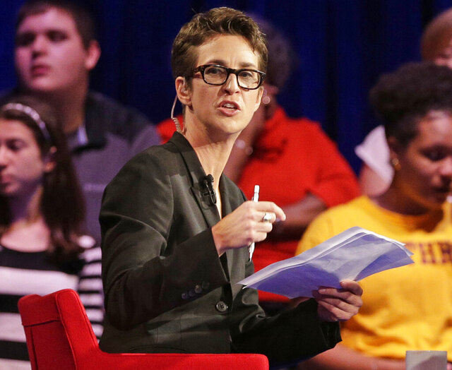 """FILE - In this Friday, Nov. 6, 2015, file photo, MSNBC's Rachel Maddow speaks during a Democratic presidential candidate forum at Winthrop University in Rock Hill, S.C. MSNBC mounted an aggressive on-air fact-checking operation during the Republican national convention, often breaking in to its telecast to question some of the claims made from the stage. Both Maddow and CNN's Daniel Dale aired """"lightning-round"""" fact-checks following President Donald Trump's acceptance speech on Thursday night. The frequency of pre-taped speeches enabled MSNBC to call in experts to help with its fact-checking. (AP Photo/Chuck Burton, File)"""