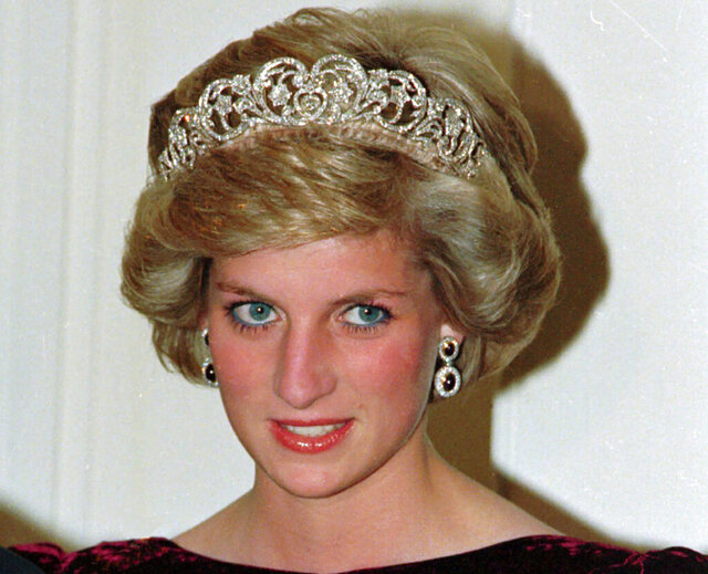 FILE - In this file photo dated Nov. 7, 1985, Britain's Princess Diana wears the Spencer tiara as she and Prince Charles attend state dinner at Government House in Adelaide, Austraila.  The BBC's board of directors has announced Wednesday Nov. 18, 2020, the appointment of a retired senior judge to lead an independent investigation into the circumstances around a controversial 1995 TV interview with Princess Diana.  (AP Photo/Jim Bourdier, FILE)