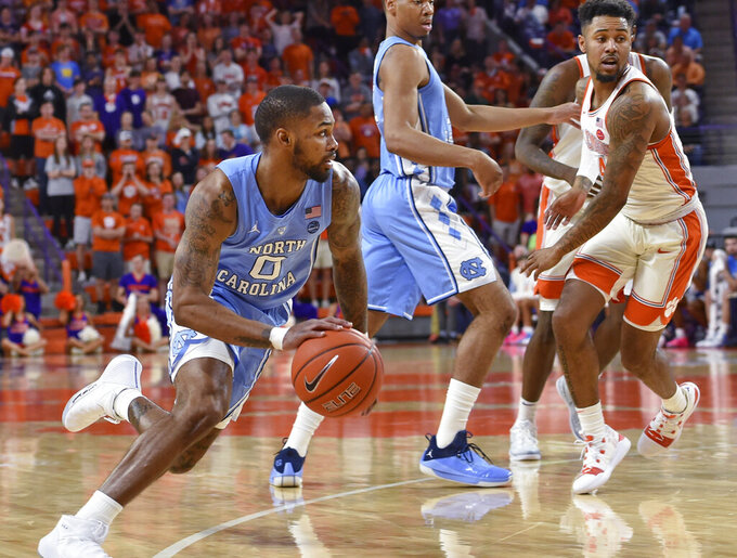 North Carolina's Seventh Woods drives during the first half of the team's NCAA college basketball game against Clemson on Saturday, March 2, 2019, in Clemson, S.C. (AP Photo/Richard Shiro)