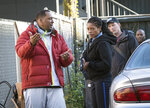 This image released by Sony Pictures shows director Deon Taylor, left, and Naomie Harris on the set of Screen Gems