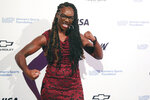 In this Wednesday, Oct. 16, 2019, photo, boxer poses Claressa Shields for photos on the red carpet of the Women's Sports Foundation's 40th annual Salute to Women in Sports in New York.  Shields, a two-time Olympic gold medalist and middleweight champion, won Sportswoman of the Year in the individual category. (AP Photo/Mary Altaffer)