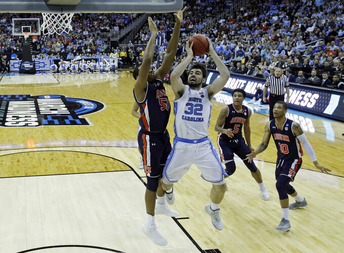 North Carolina's Luke Maye (32) shoots as Auburn's Austin Wiley (50), Chuma Okeke (5) and Samir Doughty (10) defend during the first half of a men's NCAA tournament college basketball Midwest Regional semifinal game Friday, March 29, 2019, in Kansas City, Mo. (AP Photo/Charlie Riedel)