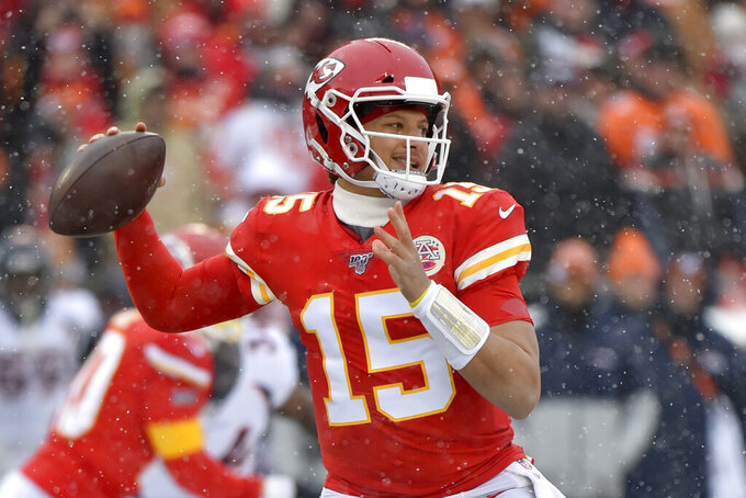 Kansas City Chiefs quarterback Patrick Mahomes (15) throws a pass during the first half of an NFL football game against the Denver Broncos in Kansas City, Mo., Sunday, Dec. 15, 2019. (AP Photo/Ed Zurga)