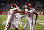 Fresno State wide receiver KeeSean Johnson (3) celebrates with teammate Markus Boyer (51) after scoring a touchdown during the first half of an NCAA college football game against New Mexico in Albuquerque, N.M., Saturday, Oct. 20, 2018. (AP Photo/Andres Leighton)
