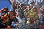 Driver Martin Truex Jr. (19) celebrates with his crew after winning the NASCAR Cup Series auto race, Monday, May 6, 2019, at Dover International Speedway in Dover, Del. (AP Photo/Will Newton)