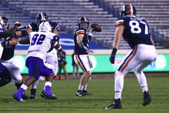 Virginia quarterback Brennan Armstrong (5) throws a pass against Abilene Christian during an NCAA college football game Saturday, Nov. 21, 2020, in Charlottesville, Va. (Erin Edgerton/The Daily Progress via AP)