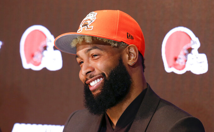 FILE - In this April 1, 2019, file photo, Cleveland Browns' Odell Beckham answers questions during an NFL football news conference in Berea, Ohio. The star wide receiver reported to the team's headquarters Monday and is on the field Tuesday, May 14, 2019, for practice. (AP Photo/Ron Schwane, File)